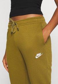 Nike Sportswear - Tracksuit bottoms - olive flak/white - 4