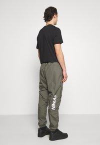 Nike Sportswear - AIR PANT  - Tracksuit bottoms - twilight marsh - 2