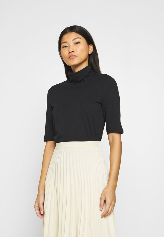 FLOW CORE - T-shirts - black