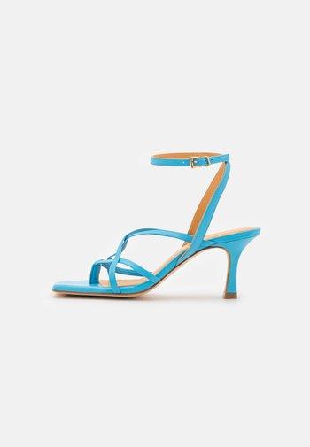 T-bar sandals - clear blue