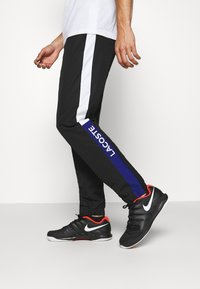 Lacoste Sport - TENNIS PANT - Tracksuit bottoms - black/cosmic white - 3