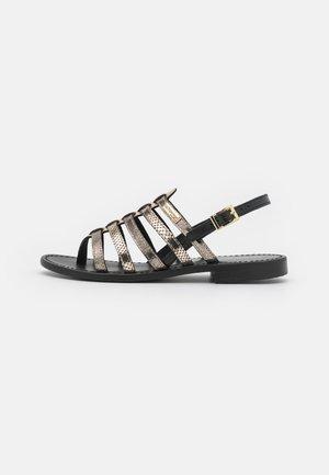 HERIBLAK - T-bar sandals - noir/or