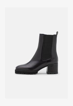JANE - Korte laarzen - schwarz
