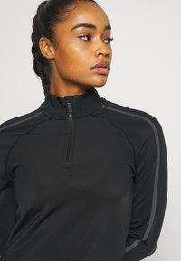 Sweaty Betty - THERMODYNAMIC HALF ZIP REFLECTIVE - Fleecová mikina - black - 5