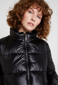 Guess - FELICIA REVERSIBLE JACKET - Winter jacket - jet black - 4