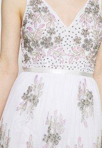 Maya Deluxe - EMBELLISHED BOW BACK DRESS - Společenské šaty - white - 5
