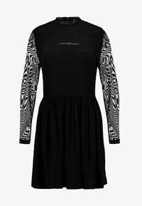 Calvin Klein Jeans - SKATER DRESS - Denní šaty - black - 4