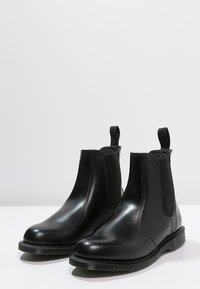 Dr. Martens - FLORA - Classic ankle boots - black polished smooth - 3