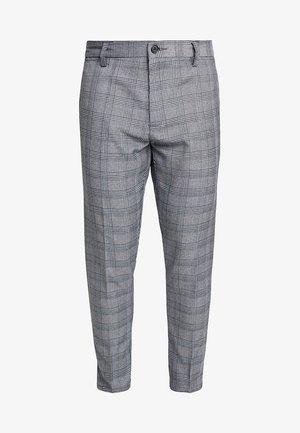 THOMAS - Trousers - black/white