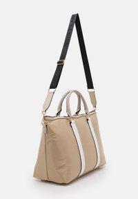 River Island - Weekend bag - beige light - 1