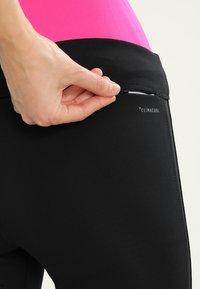 adidas Performance - 3/4 sports trousers - black/black - 3