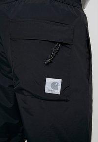 Carhartt WIP - DEXTER PANT - Joggebukse - black - 3
