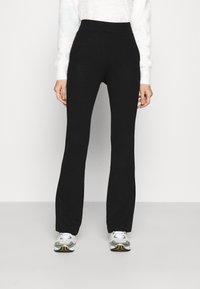 NA-KD - FLARED LOUNGE PANTS - Tracksuit bottoms - black - 0
