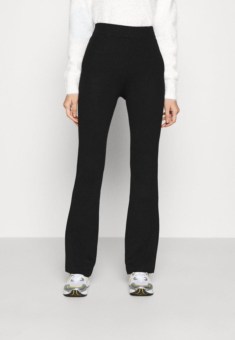 NA-KD - FLARED LOUNGE PANTS - Tracksuit bottoms - black