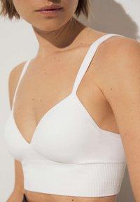 OYSHO - Medium support sports bra - white - 3