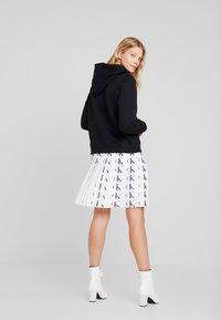 Calvin Klein Jeans - PLEATED SKIRT - A-line skirt - white/black - 2
