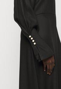 Mother of Pearl - MIDI DRESS WITH BUTTON SLEEVE - Koktejlové šaty/ šaty na párty - black - 5