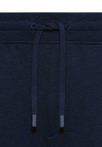 HUGO - DOHAGI - Tracksuit bottoms - dark blue - 5