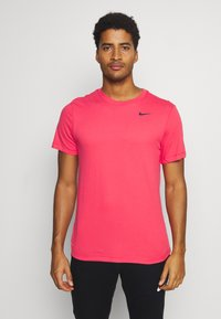 Nike Performance - TEE CREW SOLID - Basic T-shirt - light fusion red/black - 0