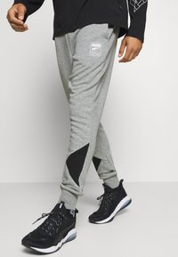 Puma - REBEL PANTS BLOCK - Pantalon de survêtement - medium gray heather - 0