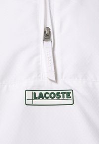 Lacoste Sport - BH1511 - Training jacket - white/navy blue/utramarine/green