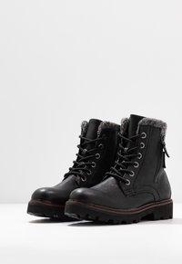 TOM TAILOR - Kotníkové boty na platformě - black - 4