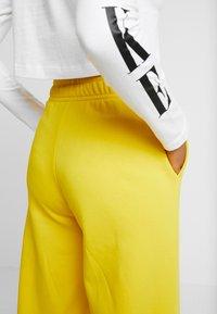 Nike Sportswear - PANT  - Træningsbukser - speed yellow/black - 3