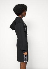 Versace Jeans Couture - SKIRT LOGO TAPE - Pencil skirt - black - 3