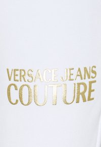 Versace Jeans Couture - Tracksuit bottoms - optical white/gold - 6