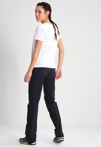 Vaude - WOMENS FARLEY STRETCH ZIP PANTS - Bukse - black - 2