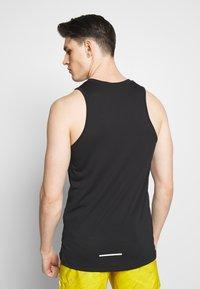 Nike Performance - DRY MILER TANK TECH - Sports shirt - black/lemon - 2
