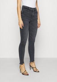 American Eagle - SUPER HI-RISE - Slim fit jeans - blue black - 0