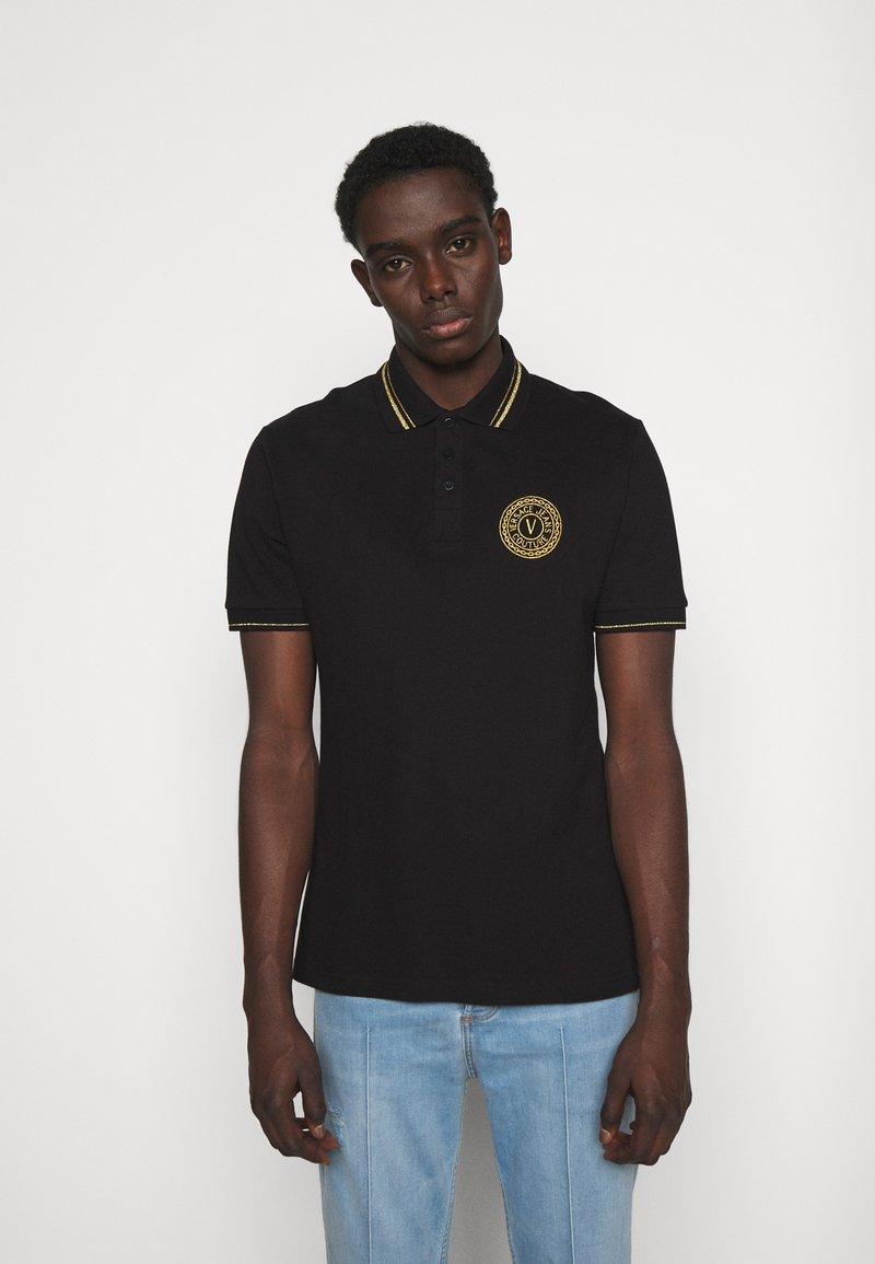 Versace Jeans Couture - PLAIN  - Polo shirt - black/gold