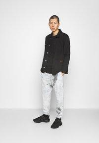 Nike Sportswear - Tracksuit bottoms - smoke grey/iron grey/white - 1