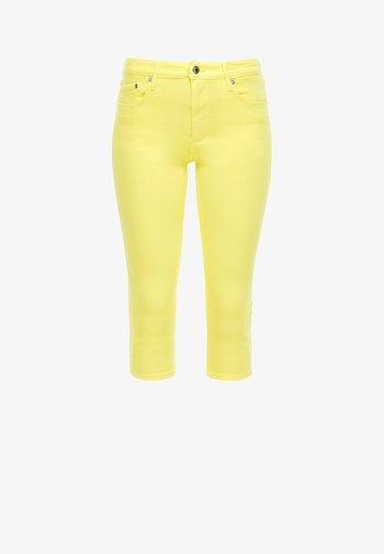 CAPRI - Denim shorts - light yellow stret