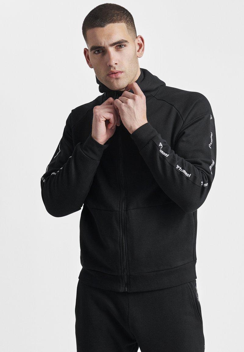 Hummel - HMLSCORPIUS  - Zip-up hoodie - black