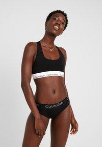 Calvin Klein Underwear - HIGH LEG TANGA - Underbukse - black - 1