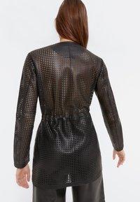 Uterqüe - 00665551 - Leather jacket - black - 3