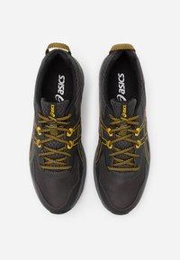 ASICS - SCOUT - Trail running shoes - graphite grey/saffron - 3
