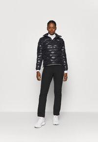 Peak Performance - HELIUM CITY LINER - Winter jacket - black - 1