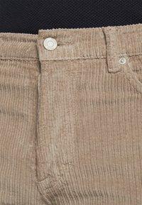 HUGO - Trousers - light pastel brown - 6