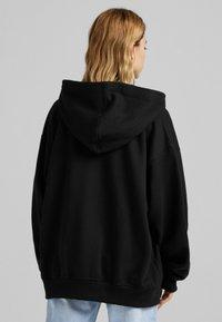 Bershka - OVERSIZE - Zip-up sweatshirt - black - 2