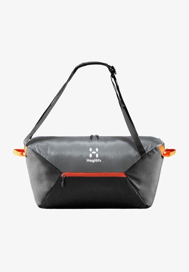 TEIDE 40 - Sports bag - true black/habanero