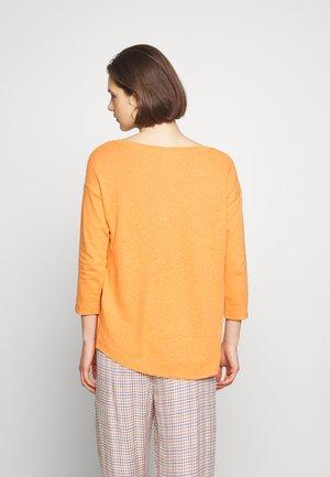 Strikkegenser - rust orange