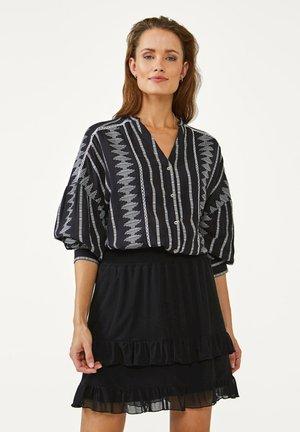 MAXIEME PES 361 - A-line skirt - black