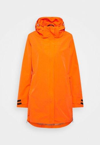 INKARILA - Waterproof jacket - dark orange