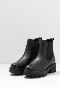 Tamaris - BOOTS - Platform ankle boots - black - 4
