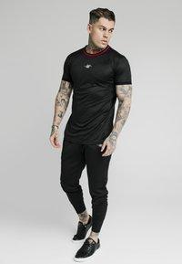 SIKSILK - SIKSILK TRANQUIL DUAL CUFF PANT - Pantaloni sportivi - black - 1