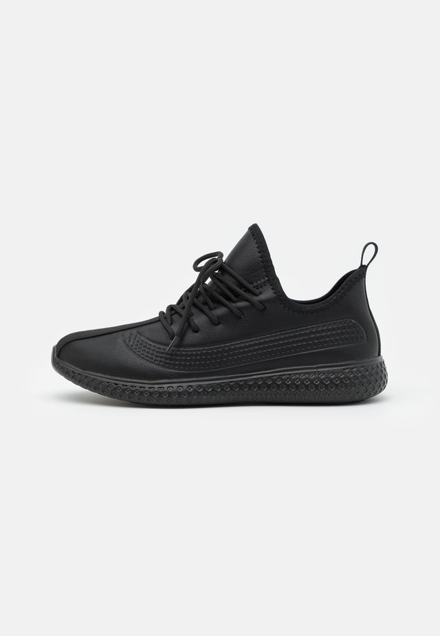 TOMAS - Trainers - black