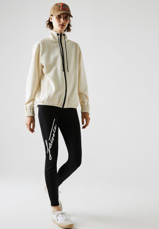 Pantalon de survêtement - schwarz / weiß